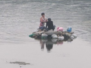 Waschtag auf dem Lijang-Fluss